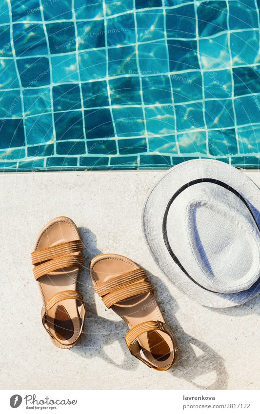 flat lay of woman's sandals and hat front of the pool Background picture Blue Hat Vacation & Travel Hot Hotel Leisure and hobbies Lifestyle Deserted