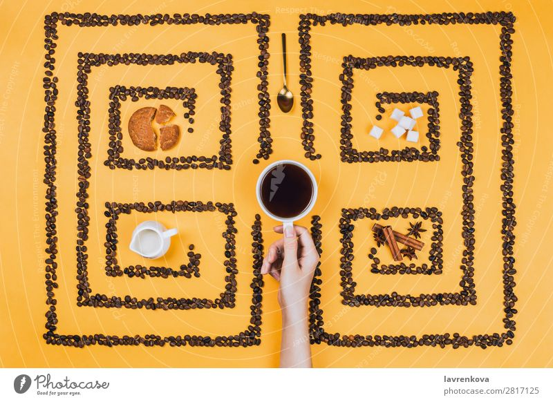 Cup in the middle of pattern or labyrinth of coffee beans Cinnamon anise stars Herbs and spices Lump sugar Cookie lay flat Yellow Espresso Mug Saucer creamer