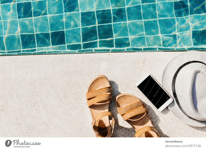 flat lay with sandals, hat and smartphone in front of the pool Background picture Blue Hat Vacation & Travel Hot Leisure and hobbies Deserted Swimming pool