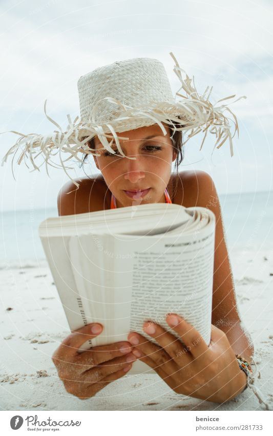 beach-reading-crazy Woman Human being Beach Vacation & Travel Reading Book Education Portrait photograph Hat Sunhat Relaxation Break Summer Produce Study Novel