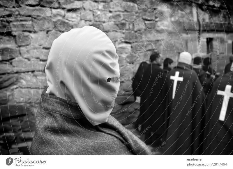 Holy Week in Spain Lifestyle Emotions Happy Religion and faith Christianity flagellation man Street life Black & white photo Exterior shot Morning