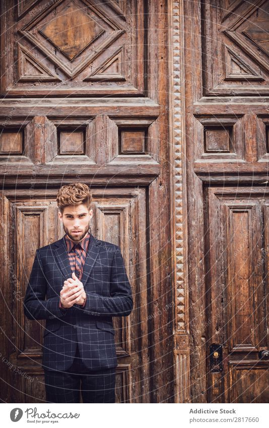 Handsome elegant young fashion man in trendy costume suit, old door wooden background Suit Man Gentleman Fashion fashionable Clothing Style Model Shirt