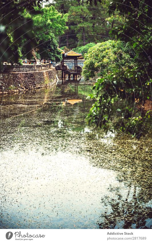 Tomb of Tu Duc emperor in Hue, in a rainy day, Vietnam - A UNESC an Ancient Architecture Asia asian Attraction Building burial Carving Complex cultural Culture
