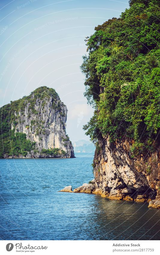 Picturesque sea landscape. Ha Long Bay, Vietnam Halong bay Asia Island Landmark Rock Blue asian Cruise Green Tree South Vietnamese Watercraft Village Dinghy