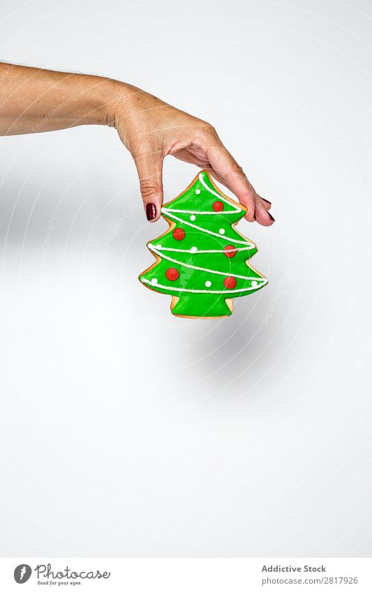 Hand with fir cookie Christmas & Advent Decoration Small Green Tradition Cookie Sweet Icing Baked goods bauble Human being Feasts & Celebrations Winter Home