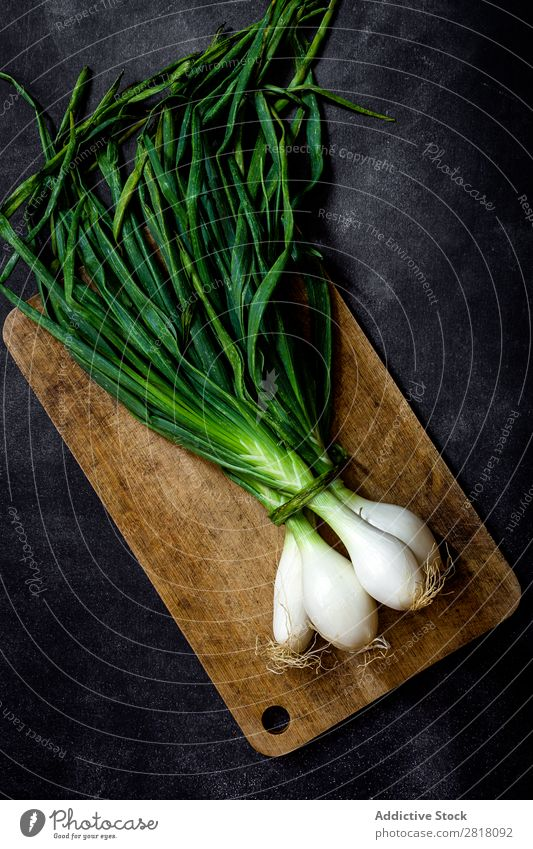 Fresh onions on dark table Fruit Food Background picture Diet Green Healthy Natural Organic Raw Agriculture Mature Table Bird's-eye view Vegetable