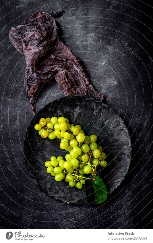 Fresh grapes on dark table Bunch of grapes Fruit Food Background picture Diet Green Healthy Natural Organic Raw Agriculture Mature Table Bird's-eye view