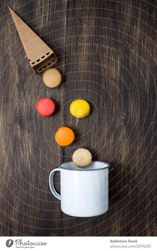 Tasty french macarons on a wooden table Macaron Food Table Deserted Dessert Snack Yellow Cake Chocolate Gourmet biscuit Wood French Colour Multicoloured