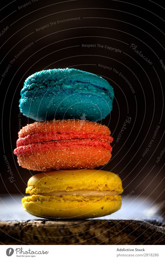 Appetizing colorful macaroons Macaron Dessert Food Candy Sweet Colour Coffee Yellow Blue Green Orange French delicious chocolate Close-up Sugar Vertical
