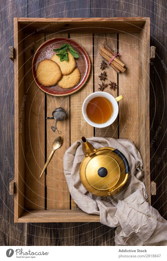 Teapot with cup of green tea with mint Mint Cinnamon Bird's-eye view Napkin Drinking Hot Food biscuits delicious Healthy Natural Wood Wooden box Close-up