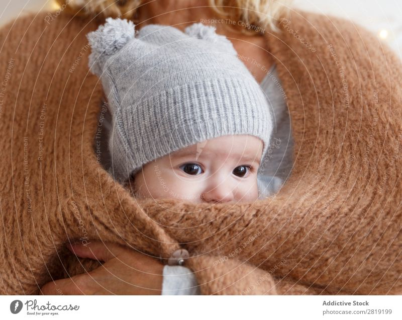 baby inside the jacket Baby Child Boy (child) mum Mother Jacket Grandmother Nice Cool (slang) Cute pretty Beauty Photography Small Eyes Smiling Human being Hand
