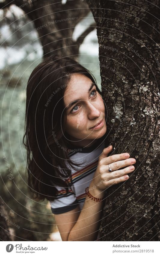 Pretty woman standing at tree Woman Tree Forest Youth (Young adults) hiding Looking away Girl Nature Human being Beautiful Park Leisure and hobbies Lifestyle