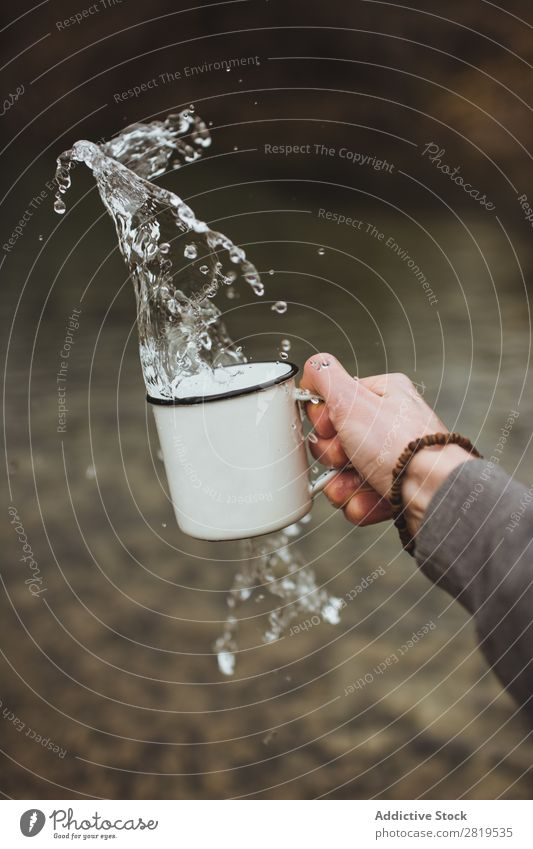 Hand splashing water from cup Splashing Water Cup Clean Healthy pouring Fresh Drop Drinking Liquid Purity Clear Wet Refreshment Washing Transparent Environment