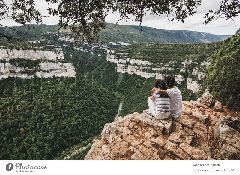 Couple sitting on cliff Cliff Landscape Nature Vacation & Travel Rock Adventure Man Woman Freedom Together Relationship Youth (Young adults) Love Embrace