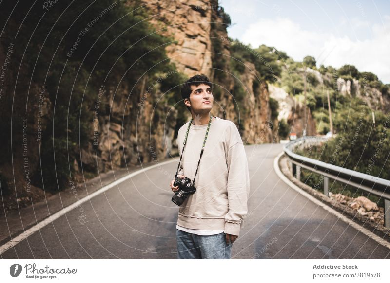 Man with camera walking in a rural road Camera Landscape Human being Attractive handsome Leisure and hobbies Trip Tourist Easygoing Nature Youth (Young adults)