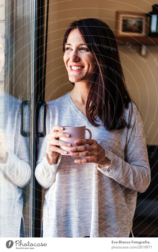 Beautiful young woman drinking coffee at home Woman Human being Youth (Young adults) Young woman House (Residential Structure) Relaxation Calm Joy Lifestyle