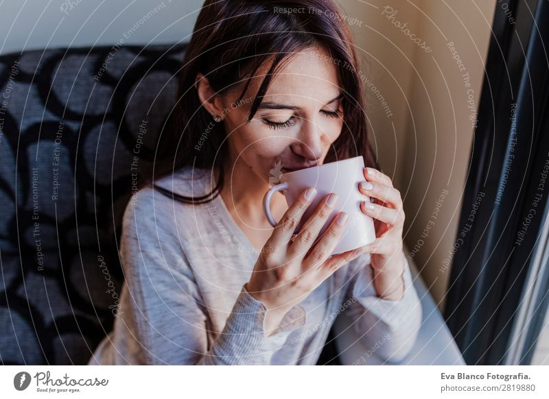 Beautiful young woman drinking coffee Woman Human being Youth (Young adults) Young woman House (Residential Structure) Relaxation Calm Joy Lifestyle Adults