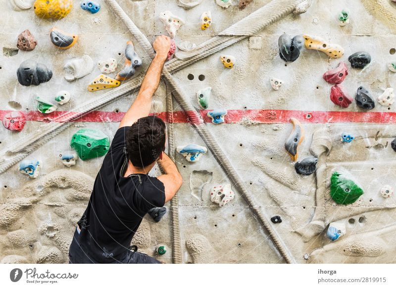 Man practicing rock climbing on artificial wall indoors. Lifestyle Joy Leisure and hobbies Sports Climbing Mountaineering Human being Masculine Adults 1