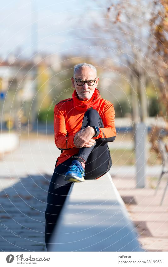 Front view of one senior man wearing sportswear and eyeglasses Lifestyle Relaxation Sports Human being Masculine Man Adults Male senior 1 60 years and older