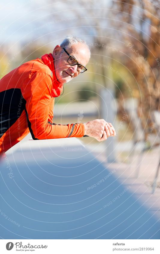 Senior runner man with sportswear leaning on a wooden fence Lifestyle Relaxation Sports Jogging Telephone Human being Masculine Man Adults Male senior 1