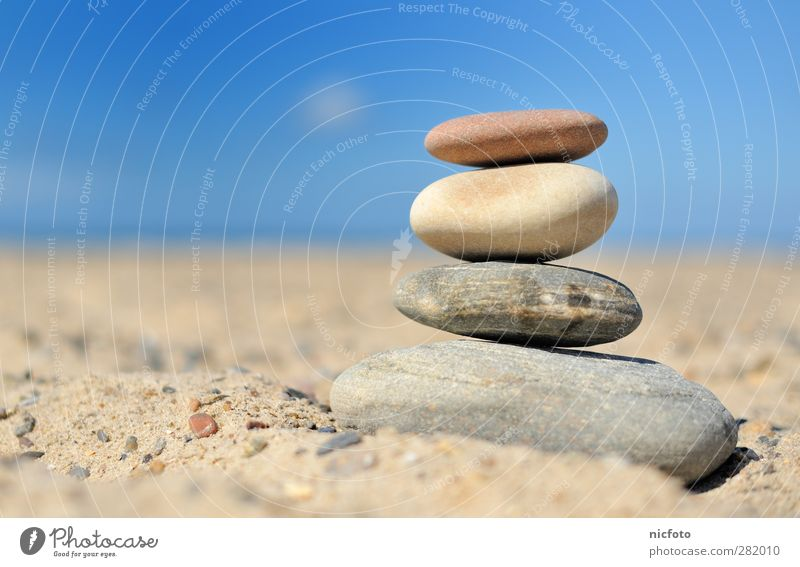 Stones on the beach Relaxation Beach Ocean Sand Beautiful weather Coast Tower Emotions Contentment Power Willpower Loyal Warm-heartedness Beginning Loneliness