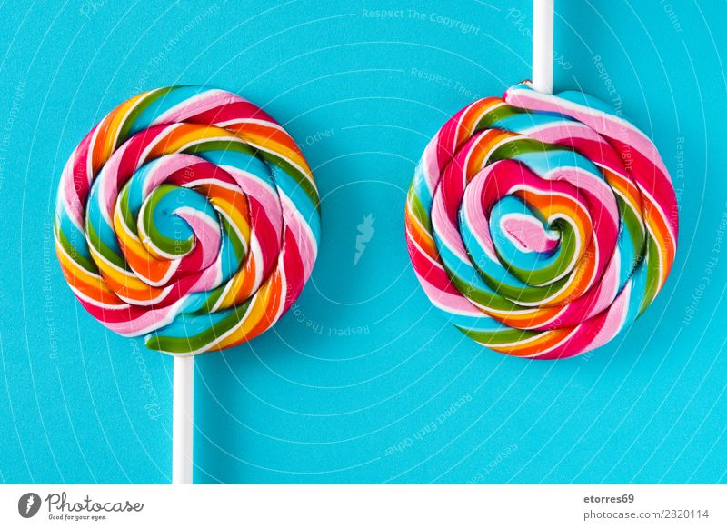 Colorful lollipops on blue background. Top view. Lollipop Colour Multicoloured Sugar Candy Sweet Tasty Neutral Background Background picture Copy Space Food