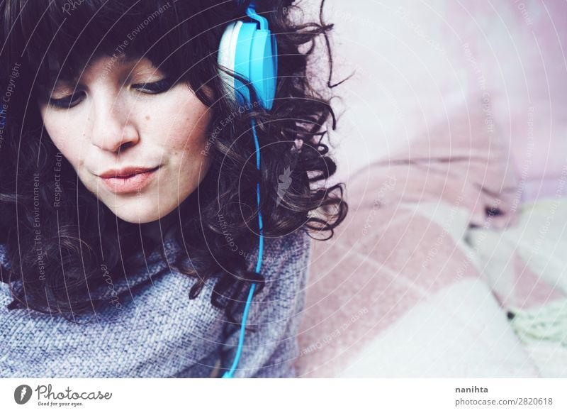 Young brunette woman listening to music Woman Human being Youth (Young adults) Young woman Beautiful White Relaxation Loneliness Joy 18 - 30 years Face