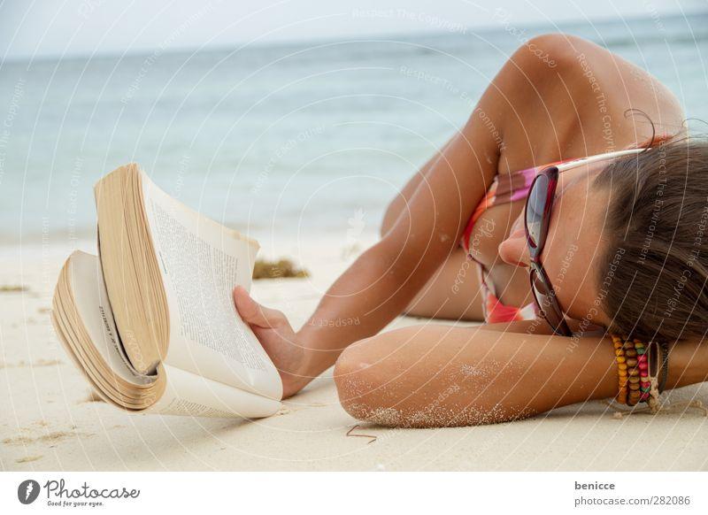 beach read Woman Human being Tourist Book Reading Eyeglasses Beach Lie Education Print media Summer Tourism Relaxation Calm Ocean Water 1 Person Brunette