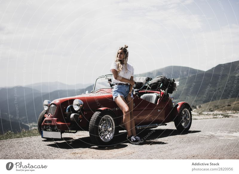 Woman standing at vintage car Car Vintage Street Red Lean Car Hood Stand Mountain Girl Youth (Young adults) Drive Vehicle Lifestyle Summer Beautiful Retro