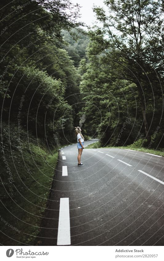 Woman walking on rod in woods Street Forest Walking Youth (Young adults) Nature Girl Lifestyle Vacation & Travel way Beautiful Asphalt Human being