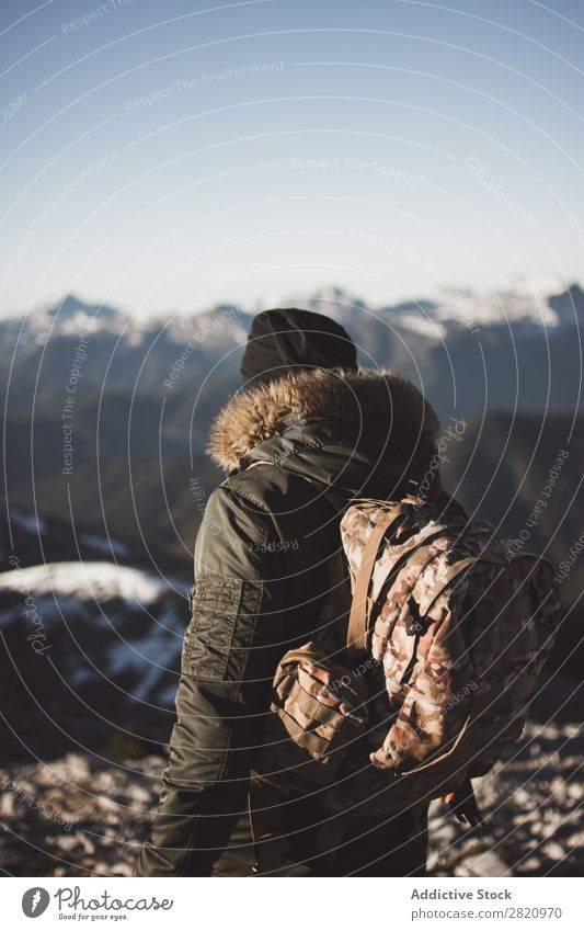 Man in outerwear on snowy mountains Mountain Snow Action Tourist Sunlight Stand Portrait photograph