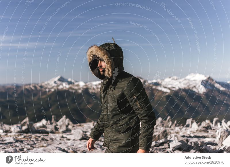 Man in outerwear on snowy mountains Mountain Snow hiker Action motivation Tourist Sunlight Stand Portrait photograph Tourism Weather Cold Extreme