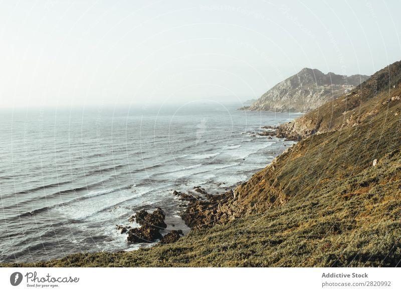 Rocky coastline of ocean Coast Ocean scenery coastal Tourism Perspective Mountain Natural Wave Landscape Adventure seascape Nature Vantage point Scene Peaceful