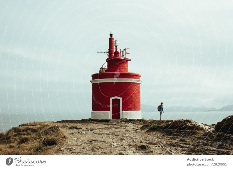 Tourist and lighthouse on coastline Human being Traveling Lighthouse Coast Nature backpacker Adventure Panorama (Format) Vantage point Landscape scenery