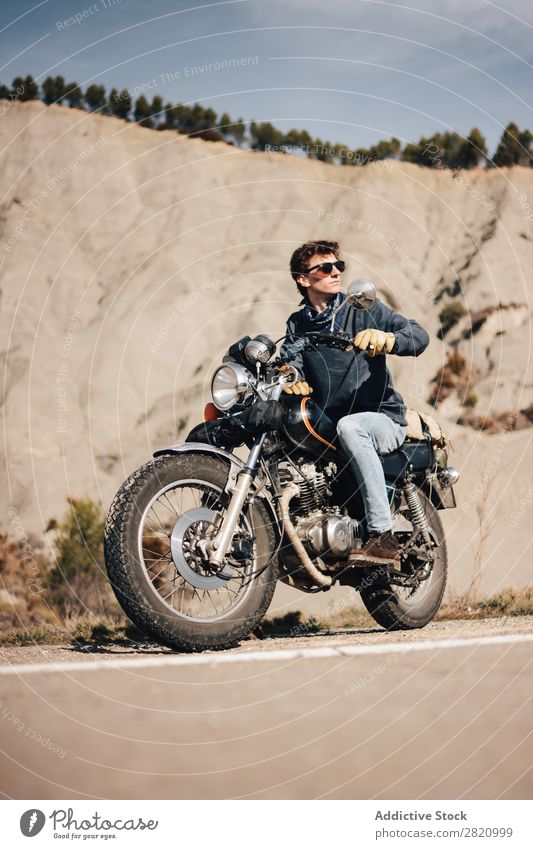 Man on bike looking away Bicycle Motorcycle Cool (slang) Looking away Roadside Motorcycling Transport Sunglasses Vehicle Lifestyle Vacation & Travel