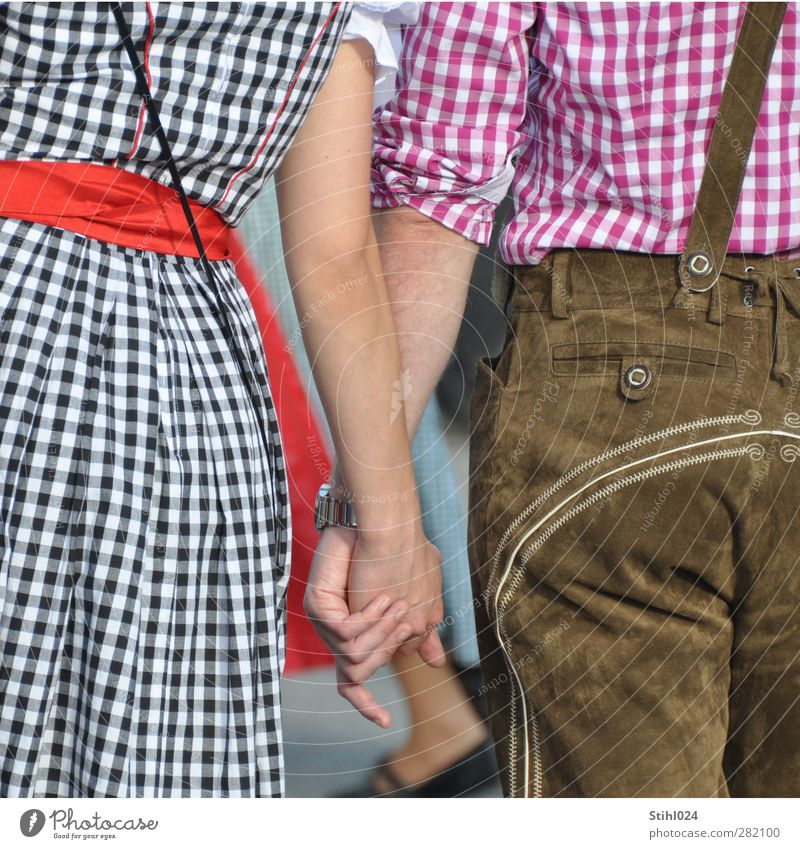Dirndl & Lederhosen Lifestyle Well-being Going out Oktoberfest Young woman Youth (Young adults) Young man Back 2 Human being 18 - 30 years Adults Shirt Skirt