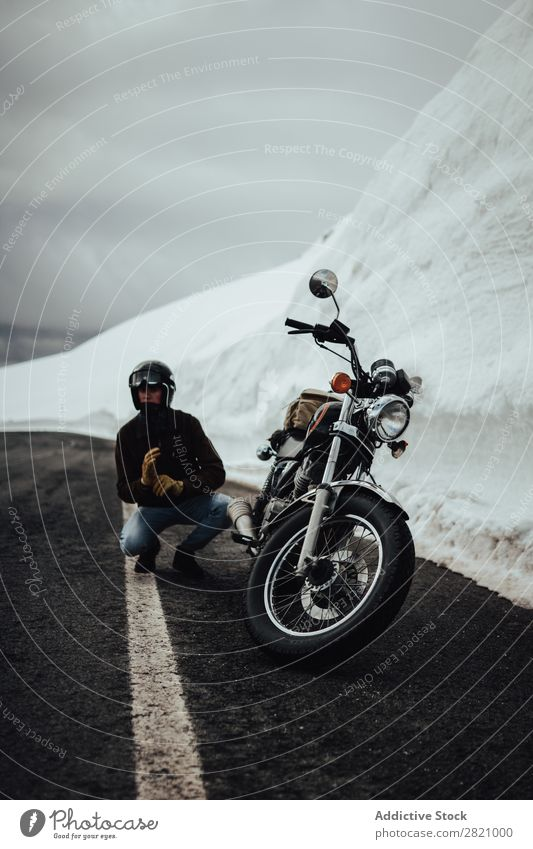 Man with motorcycle near glacier Nature Motorcycle Vacation & Travel Posture Street Transport Trip North Rider Snow Mountain Adventure Freedom Sit Landscape