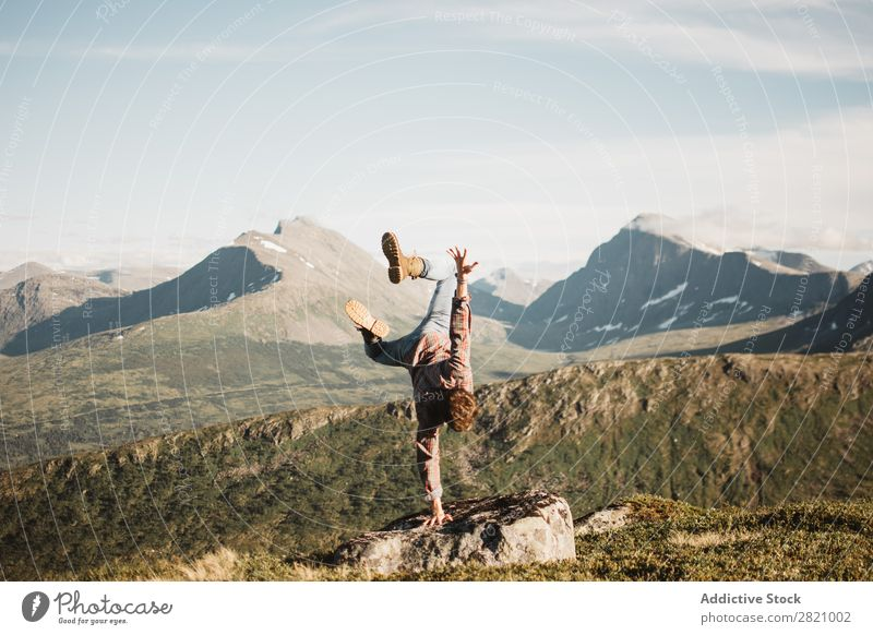 Man standing on hand on landscape Handstand Nature Mountain Landscape Extreme Balance Panorama (Format) Sports Healthy Natural traveler Valley Traveling
