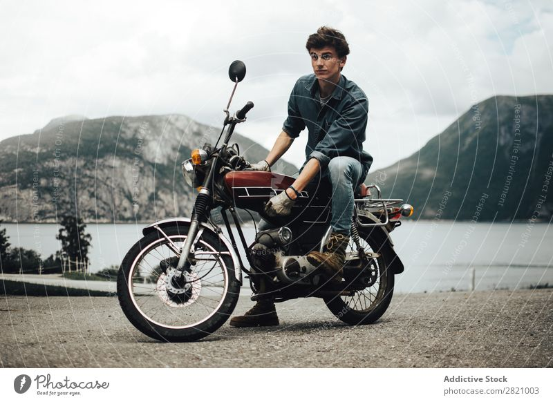 Stylish man on motorcycle Man Motorcyclist Mountain Motorcycling Landscape Posture Transport Brutal Rider Vehicle Style tranquil Vacation & Travel Wanderlust