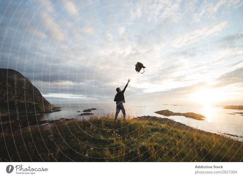Man throwing backpack on landscape Backpack Freedom Landscape Vacation & Travel Nature Exterior shot Playful Coast Peaceful enjoyment Relaxation Action catching