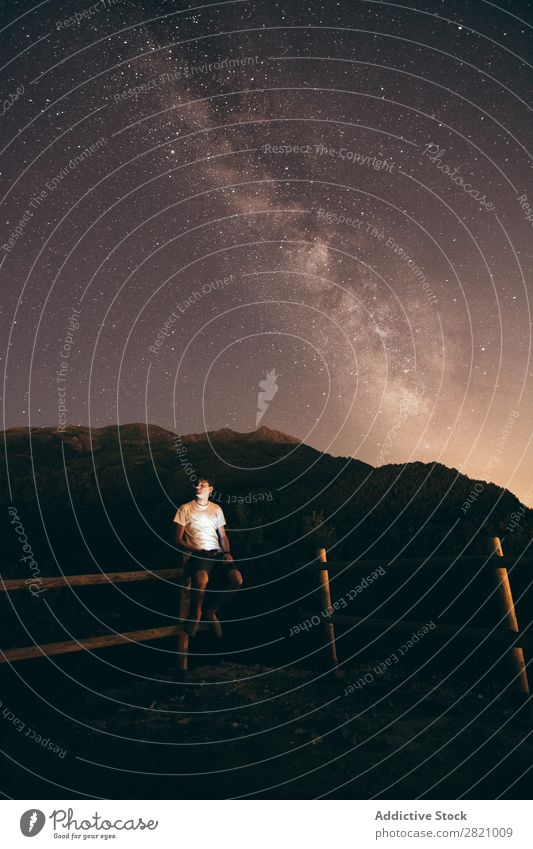 Man sitting on fence at night Night Stars Fence Wood Sit Sky Universe Light Galaxy Landscape Dark Silhouette Cosmos Astronomy Nature starry Fantasy milky way