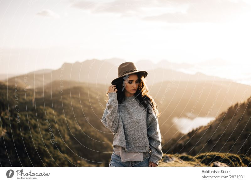 Woman standing in mountains Stand Hat Valley Posture romantic Mountain Vacation & Travel Top Rock Freedom Youth (Young adults) Nature Tourist Peak Adventure