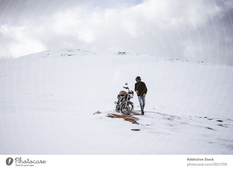 Man with motorcycle in snowy highlands Snow Motorcycle Traveling Transport Adventure Nature Panorama (Format) Tourism Trip Arranged Landscape Valley Highlands