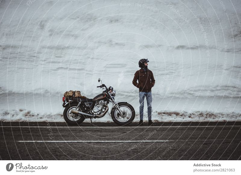 Man with motorcycle in snowy road Snow Motorcycle Traveling Transport Adventure Nature Panorama (Format) Tourism Trip Arranged Landscape Valley Highlands