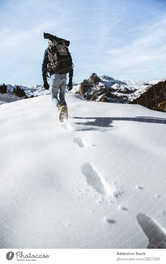 Anonymous man trekking in snows Man Backpacking Mountain Snow Extreme Hiking Adventurer Altimeter Tourism Seasons Sports Climbing Vacation & Travel hiker Winter