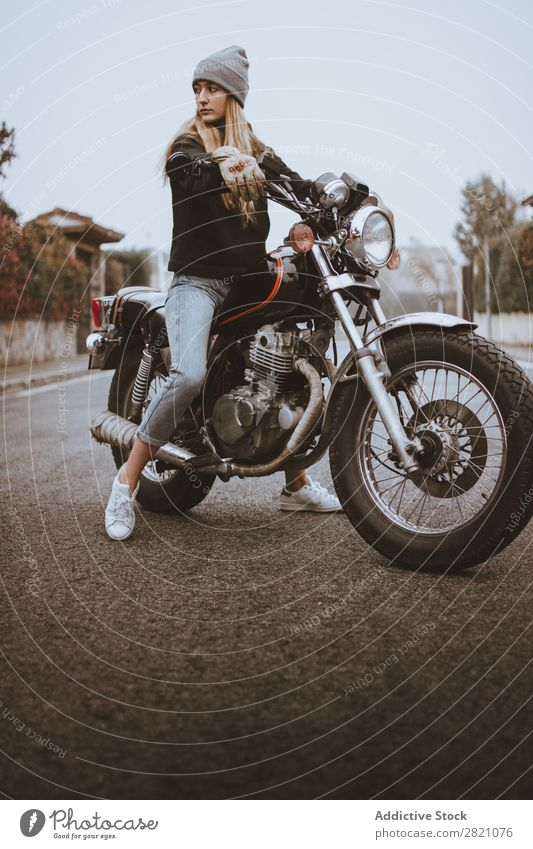 Young rebel girl posing on motorcycle Woman Motorcycle Earnest Leather Self-confident Transport Rider Rebel Uniqueness Lifestyle Vacation & Travel Nature