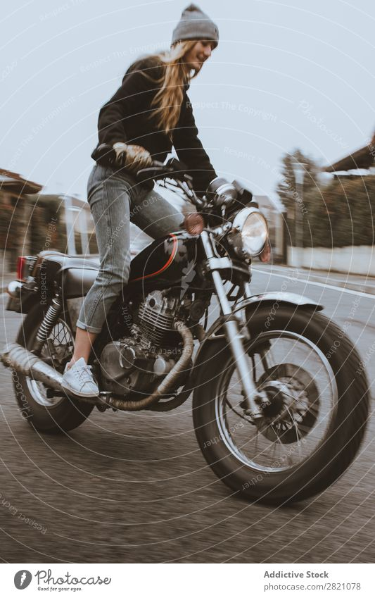 Young girl posing on motorcycle Woman Motorcycle Earnest Leather Self-confident Transport Rider Rebel Uniqueness Lifestyle Vacation & Travel Nature