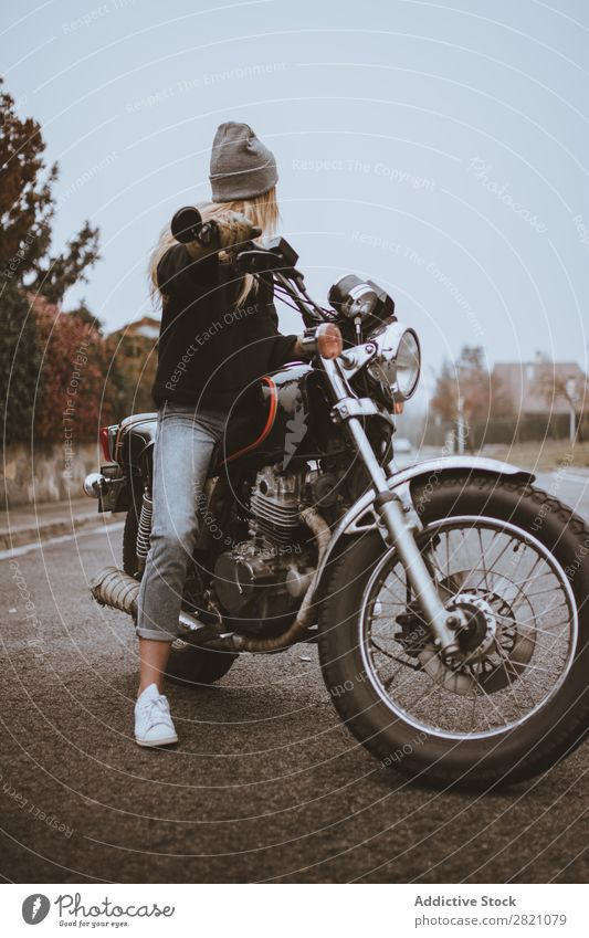 Young girl posing on motorcycle Woman Motorcycle Earnest Leather Self-confident Transport Rider Rebel