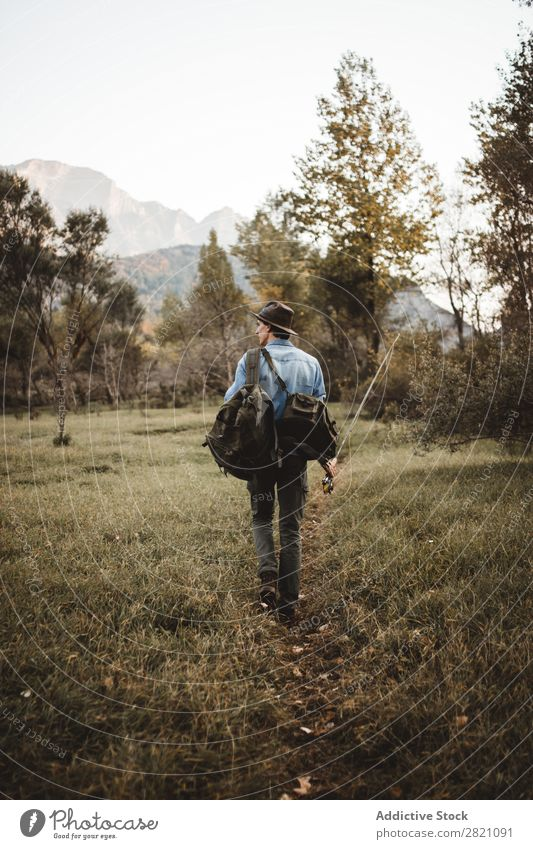 Man with backpack and rod Backpack Forest Walking Rod Nature Fisherman Angler