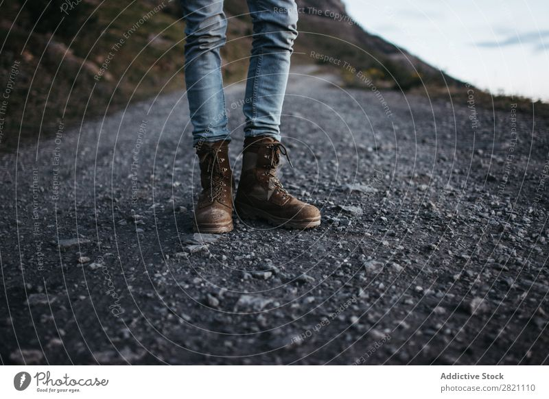 Crop traveler in boots posing Human being Boots Adventurer Street Stand Trip Vacation & Travel Hiking Tourist Leisure and hobbies Nature Tourism Footwear